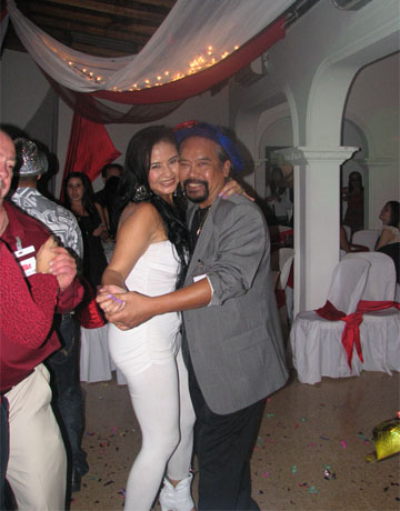 A photo of a client and one of the beautiful Latin singles dancing and enjoying